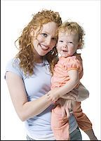 Portrait of a young woman hugging her daughter Stock Photo - Premium Royalty-Freenull, Code: 640-01351063