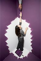 running away scared - High angle view of a mid adult woman reaching out for a man's hand Stock Photo - Premium Royalty-Freenull, Code: 640-01351455
