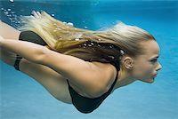Profile of a teenage girl swimming Stock Photo - Premium Royalty-Freenull, Code: 640-01351576