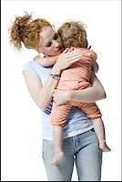 Close-up of a young woman hugging her daughter Stock Photo - Premium Royalty-Freenull, Code: 640-01351729