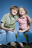 preteen thong - Portrait of a boy sitting with his arm around his sister Stock Photo - Premium Royalty-Freenull, Code: 640-01351919