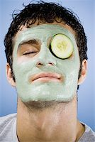 Man with mud mask and cucumber slice with closed eyes Stock Photo - Premium Royalty-Freenull, Code: 640-01352071