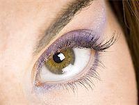 Closeup of female eye with purple eyeshadow Stock Photo - Premium Royalty-Freenull, Code: 640-01352213