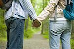 Mid section view of a young couple holding hands and standing Stock Photo - Premium Royalty-Free, Artist: AWL Images, Code: 640-01352395