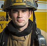 Portrait of a firefighter wearing a helmet Stock Photo - Premium Royalty-Free, Artist: Ikon Images, Code: 640-01352435