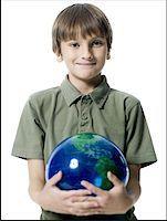 pre-teen boy models - Portrait of a boy holding a globe Stock Photo - Premium Royalty-Freenull, Code: 640-01352663