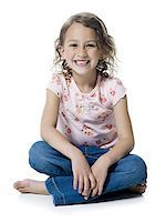 preteen  smile  one  alone - Portrait of a girl sitting with her legs crossed Stock Photo - Premium Royalty-Freenull, Code: 640-01352689