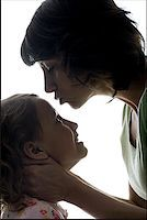 preteen kissing - Close-up of a mid adult woman kissing her daughter's forehead Stock Photo - Premium Royalty-Freenull, Code: 640-01352959