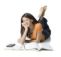 Portrait of a girl listening to music and studying Stock Photo - Premium Royalty-Freenull, Code: 640-01353558