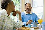 Senior man and a senior woman sitting at the breakfast table Stock Photo - Premium Royalty-Freenull, Code: 640-01353701
