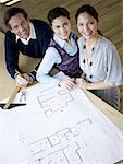 High angle view of three office workers in an office Stock Photo - Premium Royalty-Free, Artist: Kathy Quirk-Syvertsen, Code: 640-01353730