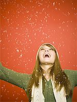 Girl looking up at snow Stock Photo - Premium Royalty-Freenull, Code: 640-01353835