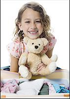 preteen  smile  one  alone - Portrait of a girl holding a teddy bear Stock Photo - Premium Royalty-Freenull, Code: 640-01353998