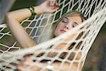 Teenage girl resting on a hammock Stock Photo - Premium Royalty-Free, Artist: imagebroker, Code: 640-01354305