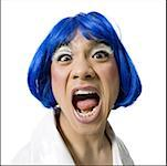Man with blue wig and makeup yelling Stock Photo - Premium Royalty-Free, Artist: AWL Images, Code: 640-01354471