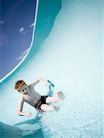 Boy on a waterslide Stock Photo - Premium Royalty-Freenull, Code: 640-01354708