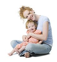 Portrait of a young woman sitting with her daughter Stock Photo - Premium Royalty-Freenull, Code: 640-01354837