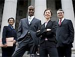 Low angle view of lawyers in front of a courthouse Stock Photo - Premium Royalty-Freenull, Code: 640-01354980