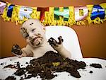 Baby eating birthday cake Stock Photo - Premium Royalty-Free, Artist: Masterfile, Code: 640-01355992