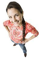 female white background full body - High angle view of a woman standing with her hands on her hips Stock Photo - Premium Royalty-Freenull, Code: 640-01356294