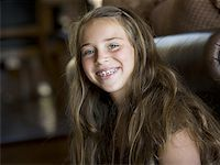 Young girl smiling Stock Photo - Premium Royalty-Freenull, Code: 640-01356315