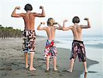 Three boys playing on beach Stock Photo - Premium Royalty-Free, Artist: Kevin Dodge, Code: 640-01356432