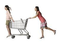 Profile of a young woman pushing a teenage girl in a shopping cart Stock Photo - Premium Royalty-Free, Artist: GreatStock, Code: 640-01356884