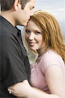 Profile of a young couple hugging Stock Photo - Premium Royalty-Freenull, Code: 640-01357112