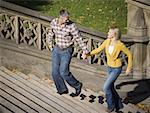 High angle view of a couple walking up stairs Stock Photo - Premium Royalty-Free, Artist: Masterfile, Code: 640-01357157