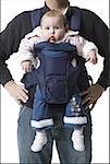 Mid section view of a mature man carrying his daughter Stock Photo - Premium Royalty-Free, Artist: Cusp and Flirt, Code: 640-01357191