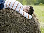 Portrait of a boy lying on a hay bale Stock Photo - Premium Royalty-Free, Artist: Eyecandy Pro, Code: 640-01357497