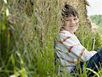 Portrait of a boy sitting against a hay bale Stock Photo - Premium Royalty-Free, Artist: Eyecandy Pro, Code: 640-01357896