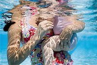 Mother and daughter in swimming pool Stock Photo - Premium Royalty-Freenull, Code: 640-01358991