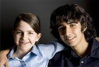 Portrait of teenage siblings smiling Stock Photo -