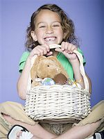 preteen thong - Portrait of a girl holding Easter eggs in a wicker basket Stock Photo - Premium Royalty-Freenull, Code: 640-01359845