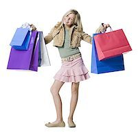 preteen  smile  one  alone - Portrait of a girl showing shopping bags and smiling Stock Photo - Premium Royalty-Freenull, Code: 640-01359881