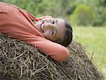 Portrait of a girl lying on a hay bale Stock Photo - Premium Royalty-Free, Artist: Robert Harding Images, Code: 640-01360190