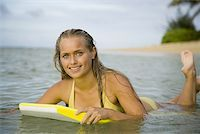 Portrait of a teenage girl floating on a boogie board in the sea Stock Photo - Premium Royalty-Freenull, Code: 640-01360277