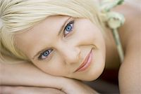 Close-up of a young woman smiling Stock Photo - Premium Royalty-Freenull, Code: 640-01360293