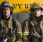 Portrait of two firefighters sitting Stock Photo - Premium Royalty-Free, Artist: Masterfile, Code: 640-01360367