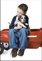 people kissing little boys - Close-up of a boy sitting on a wagon hugging a puppy Stock Photo - Premium Royalty-Freenull, Code: 640-01360603