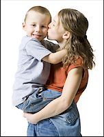 preteen kissing - Profile of a sister kissing her brother Stock Photo - Premium Royalty-Freenull, Code: 640-01360703