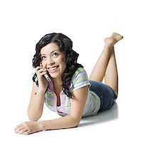 Close-up of a teenage girl talking on a mobile phone Stock Photo - Premium Royalty-Freenull, Code: 640-01361245