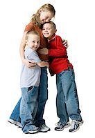 people kissing little boys - Portrait of two brothers hugging their sister Stock Photo - Premium Royalty-Freenull, Code: 640-01362403