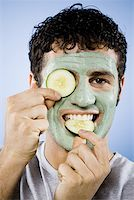 Man with facial mask and cucumber slices Stock Photo - Premium Royalty-Freenull, Code: 640-01362592