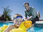 Father and son at swimming pool Stock Photo - Premium Royalty-Free, Artist: Tim Mantoani, Code: 640-01362654