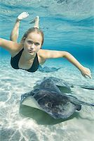 Portrait of a teenage girl swimming underwater Stock Photo - Premium Royalty-Freenull, Code: 640-01362784
