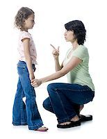 preteen thong - Close-up of a mid adult woman scolding her daughter Stock Photo - Premium Royalty-Freenull, Code: 640-01363258