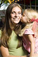 Portrait of a young woman being kissed by her daughter Stock Photo - Premium Royalty-Freenull, Code: 640-01363299