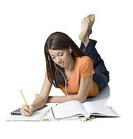 Close-up of a girl writing in a notebook Stock Photo - Premium Royalty-Freenull, Code: 640-01363599